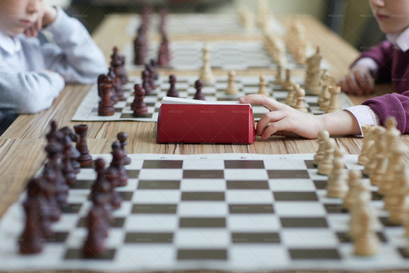 Girl Pressing Chess Clock: Stock Photos