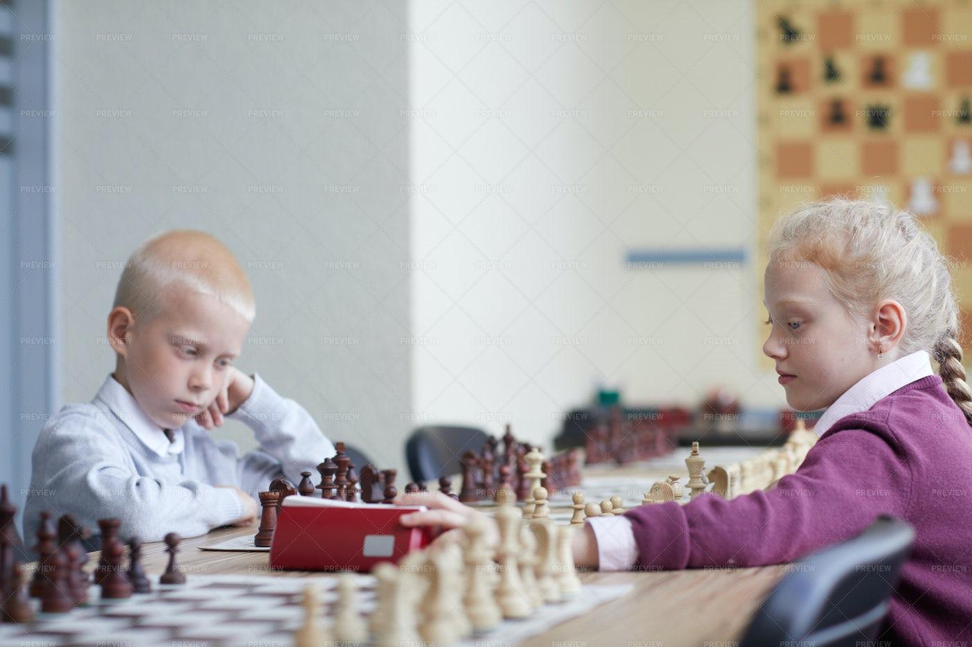 Girl Made Chess Move: Stock Photos