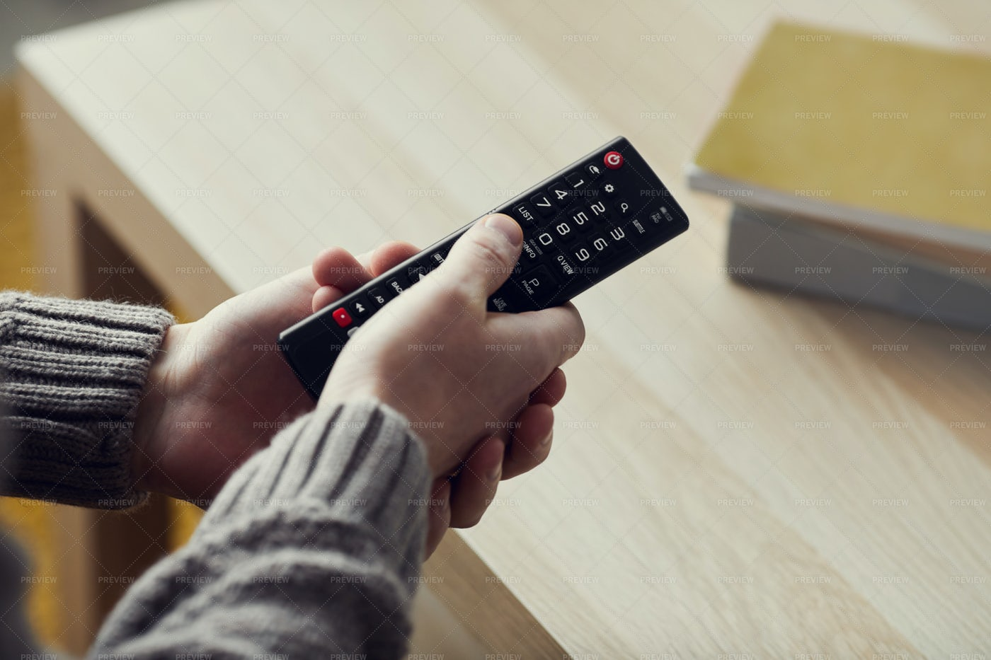 Man Holding Remote Close Up: Stock Photos