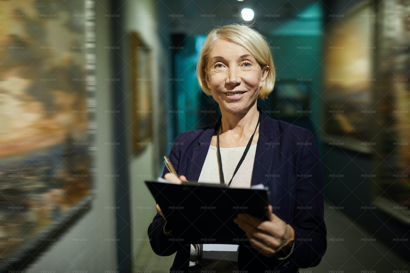 Female Art Gallery Curator: Stock Photos