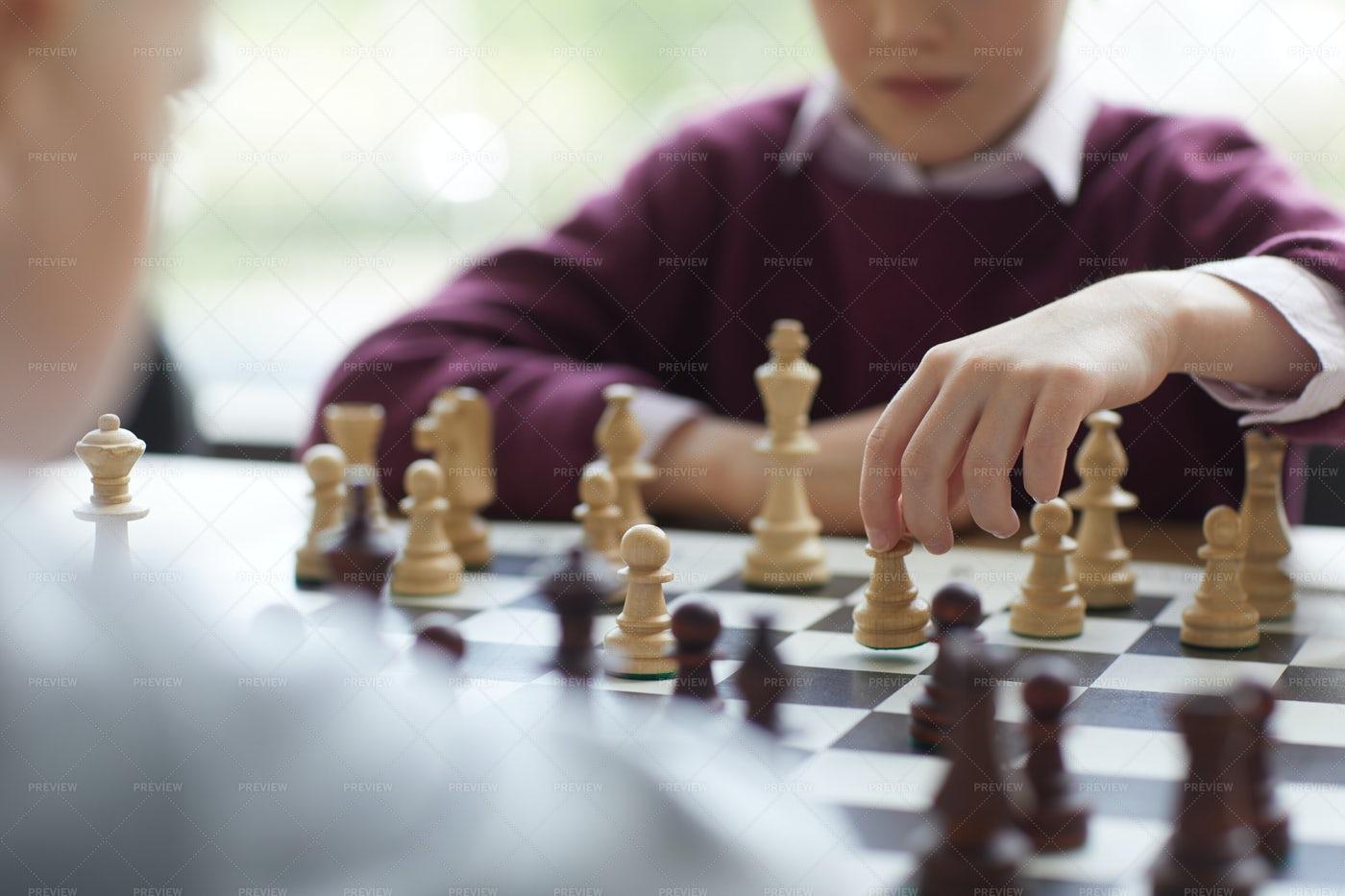 Girl Putting Chess Piece: Stock Photos