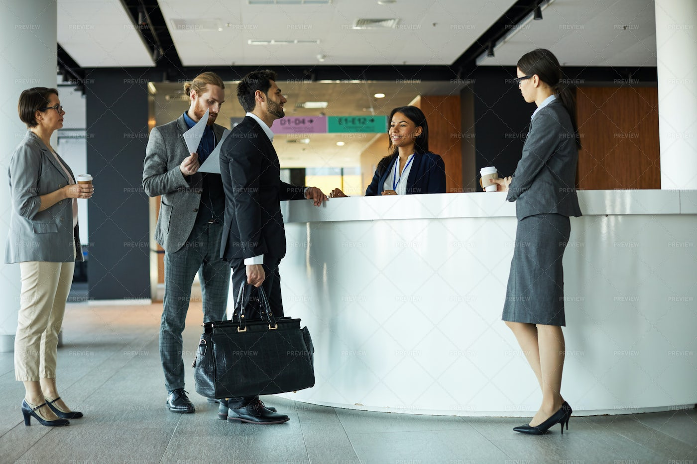 Businessman Checking In To Hotel: Stock Photos