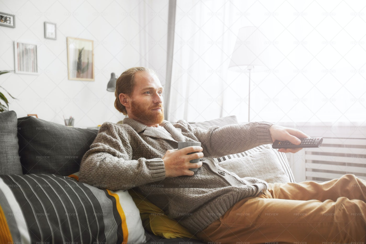 Man Relaxing At Home With TV: Stock Photos