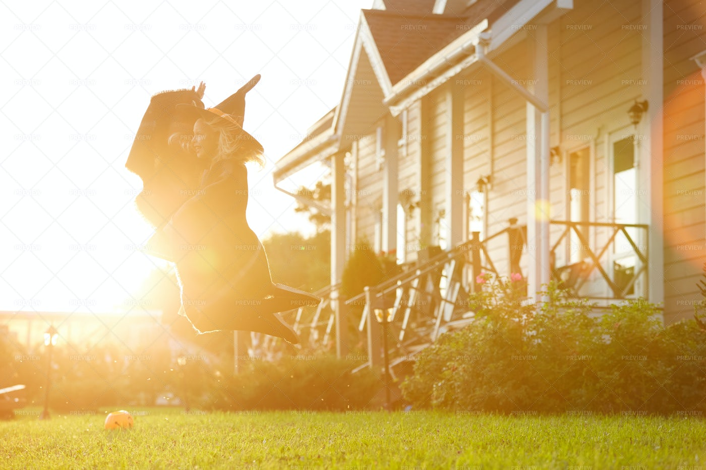 Little Witch Flying On Broom In...: Stock Photos