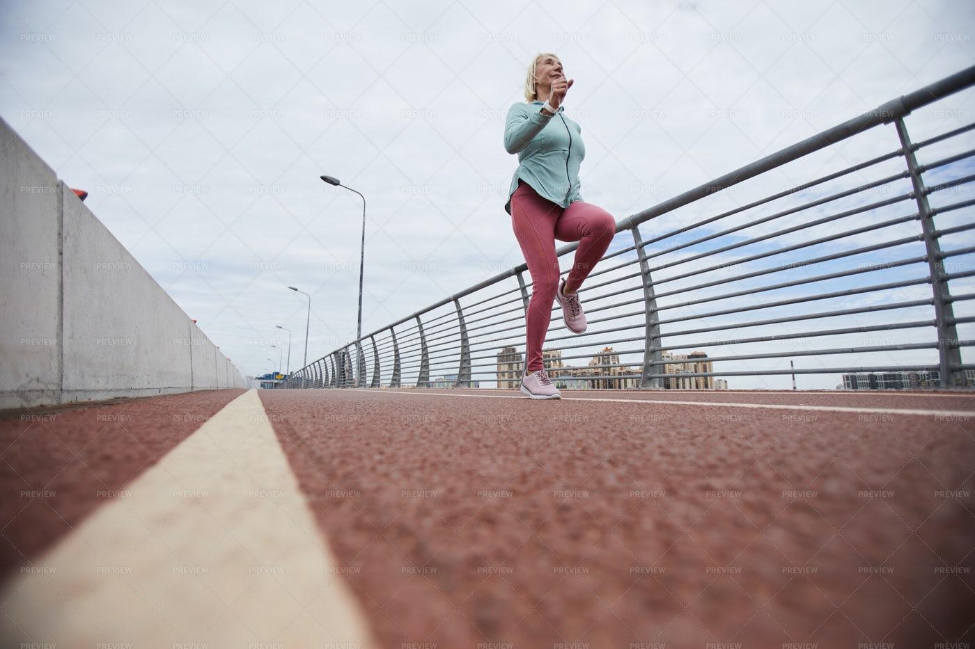 Jogging Along Bridge: Stock Photos