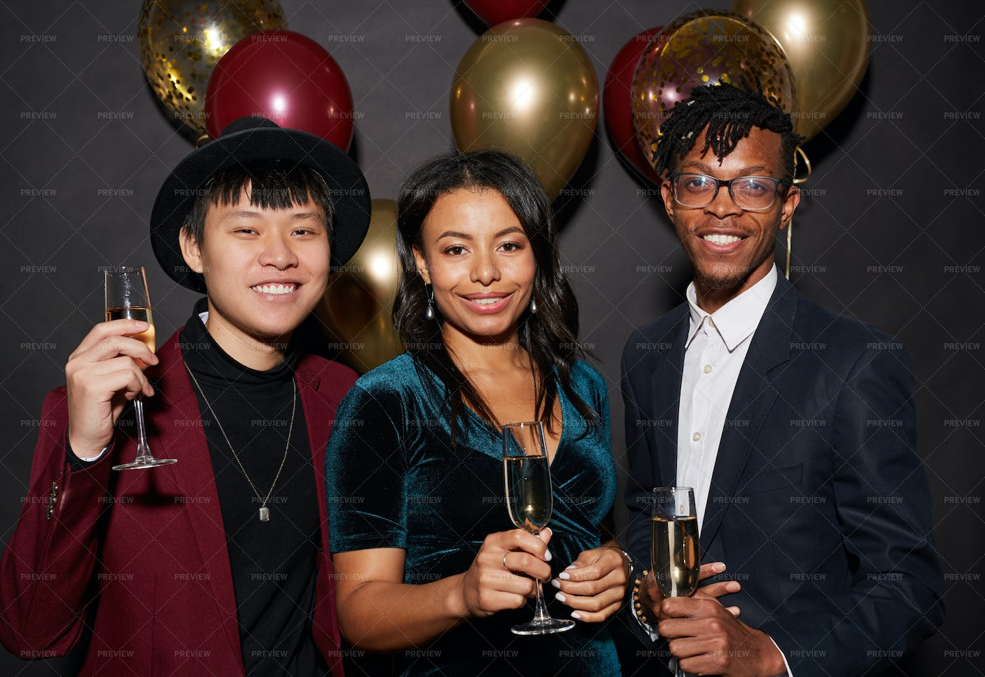 Ethnic Young People Posing At Party: Stock Photos
