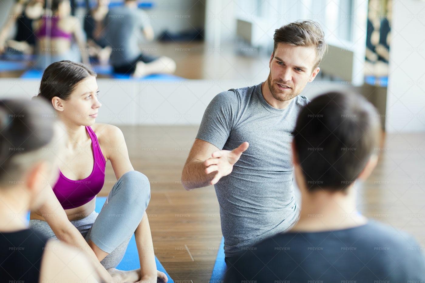 Sporty Guy Sharing Ideas At Yoga...: Stock Photos