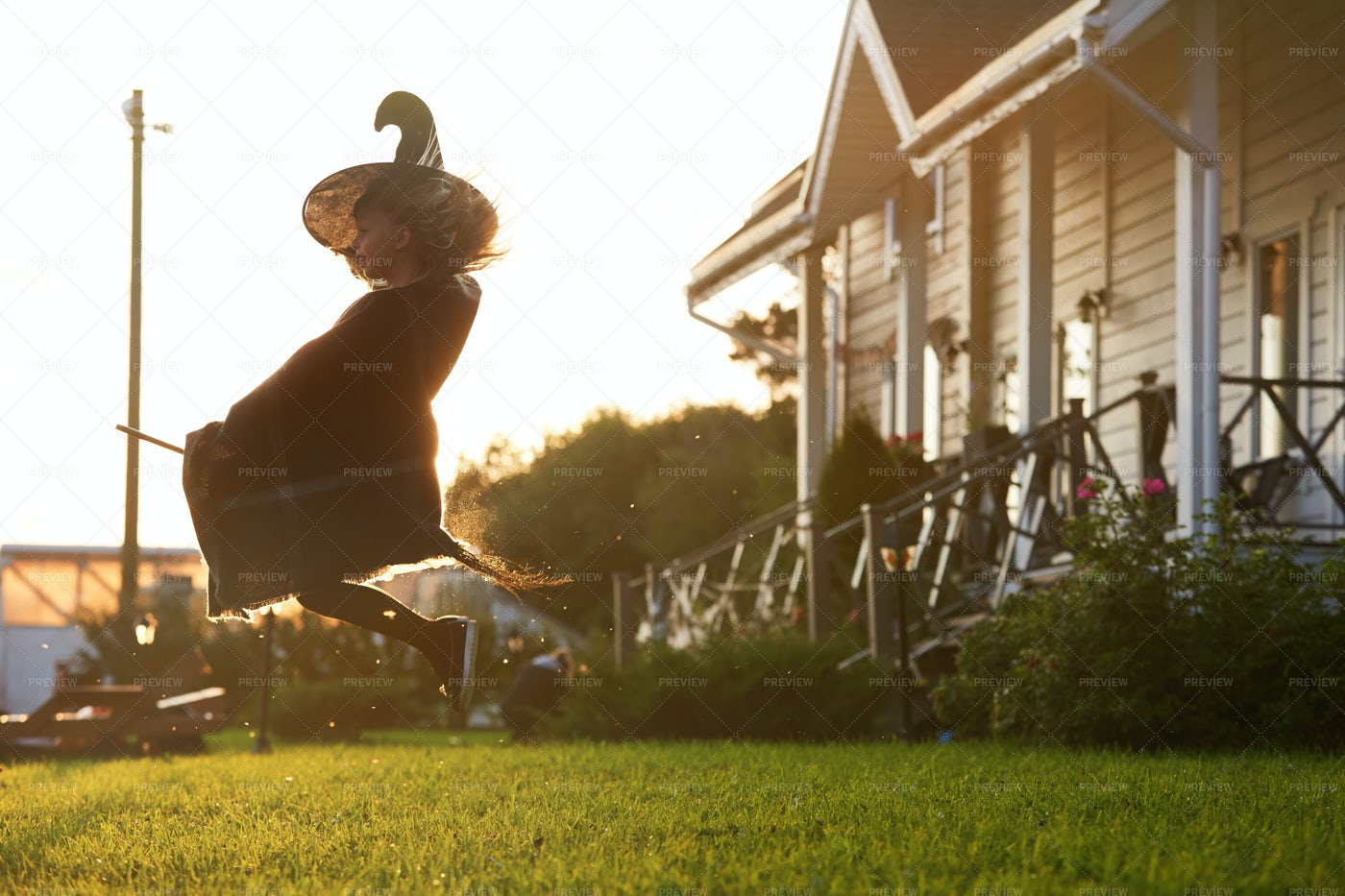 Little Witch Flying On Broom: Stock Photos