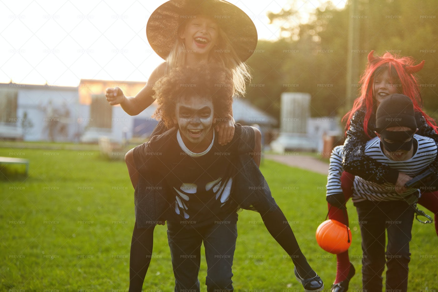 Kids Playing Outdoors On Halloween: Stock Photos