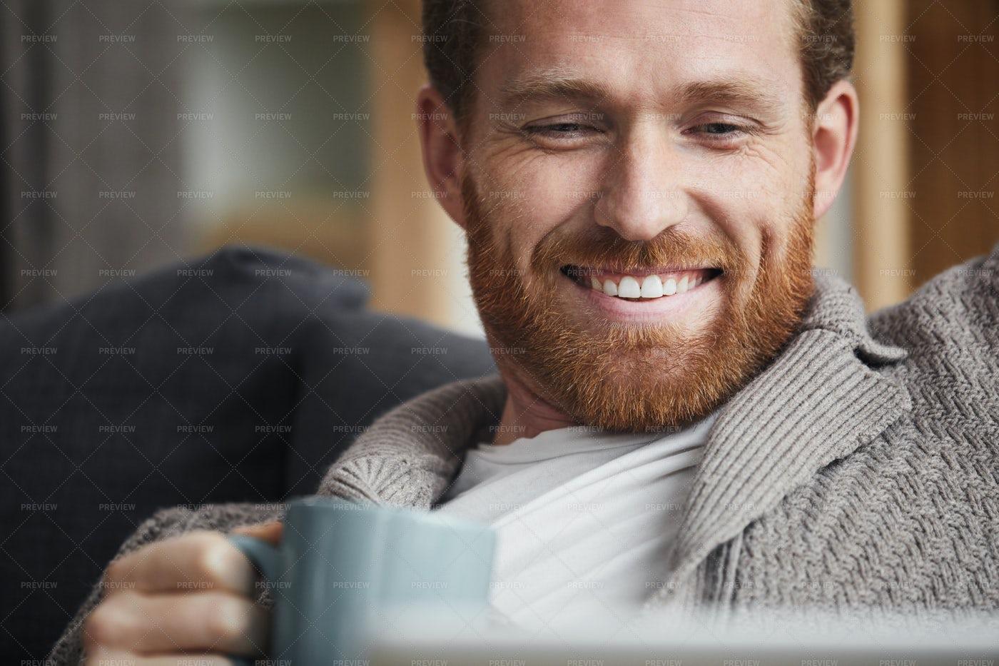 Handsome Man Enjoying TV Series At...: Stock Photos