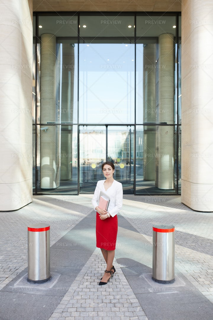 Businesswoman Posing By Entrance: Stock Photos