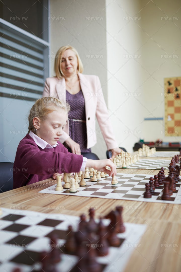 Teacher Helping With Chess: Stock Photos