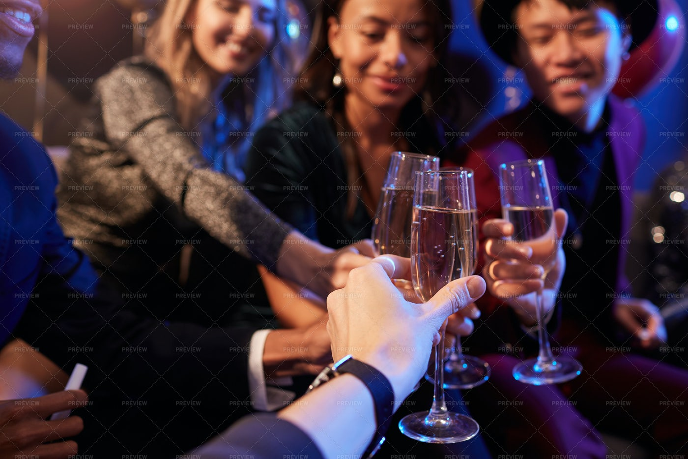 Friends Drinking Champagne At...: Stock Photos