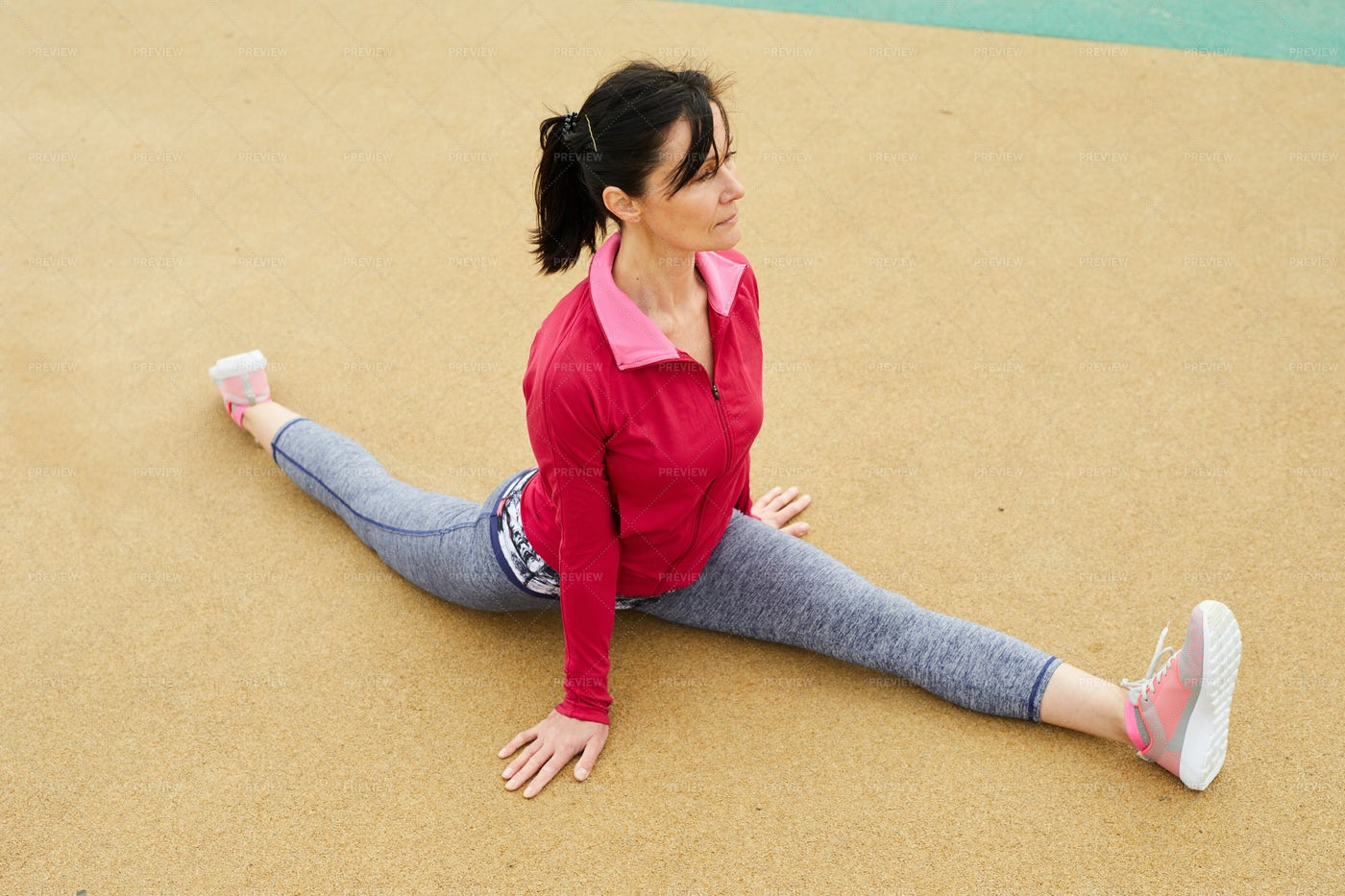Mature Woman Doing Splits: Stock Photos
