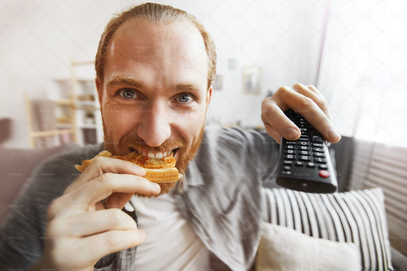 Excited Man Watching TV At Home: Stock Photos