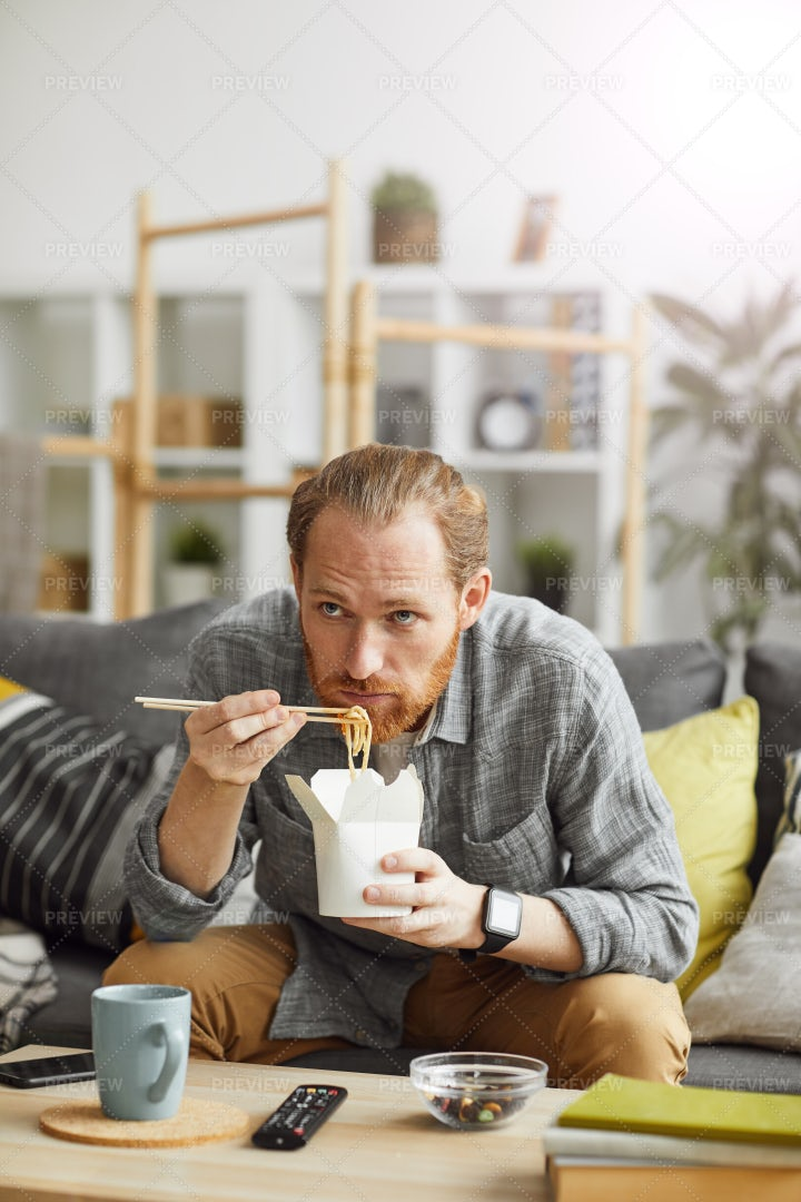 Lazy Man Watching TV At Home: Stock Photos