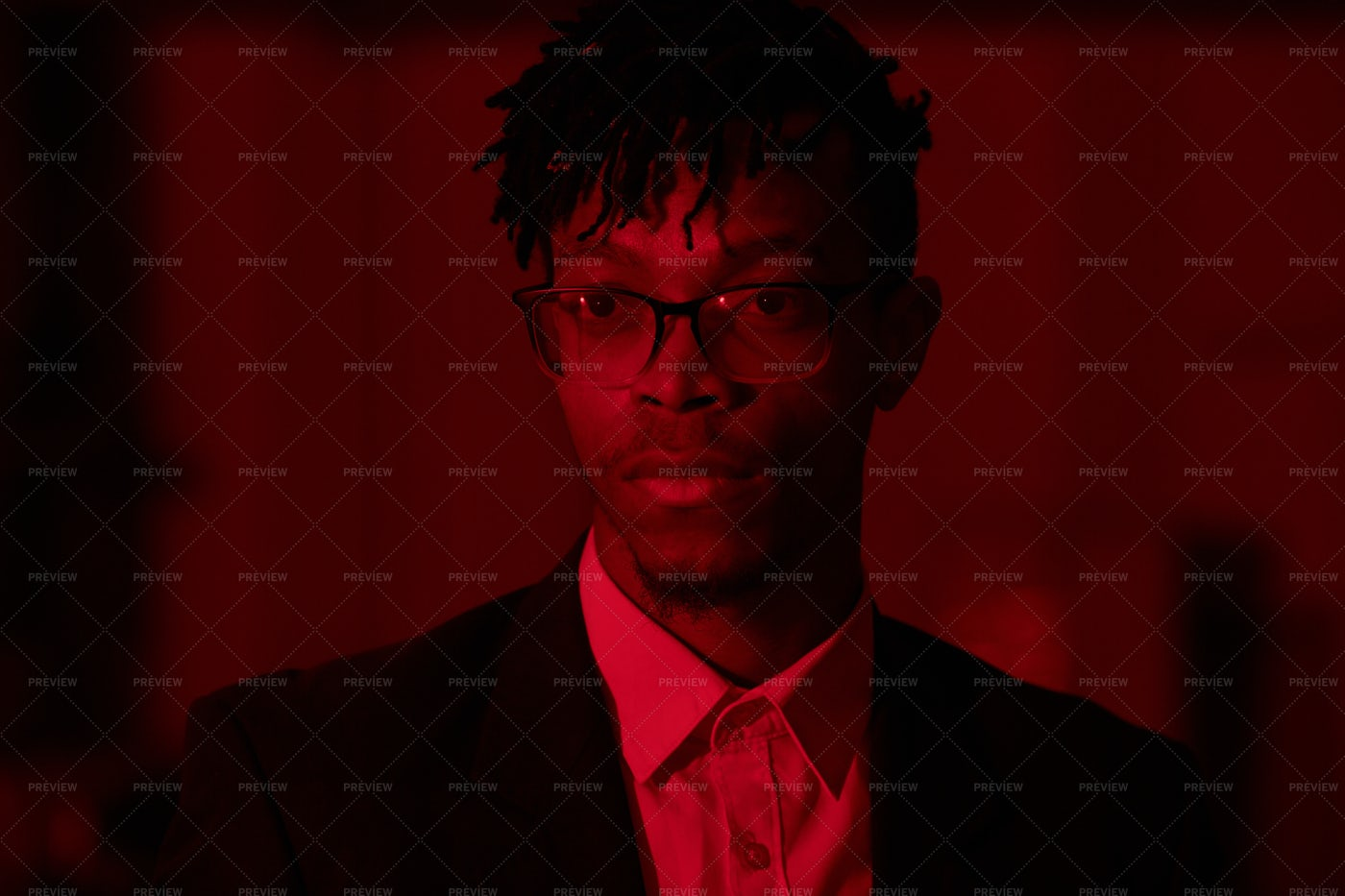 Handsome African Man In Red Light: Stock Photos