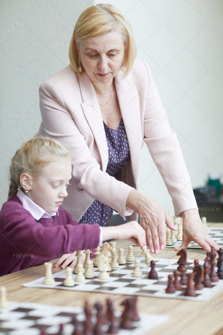 Practicing Chess With Teacher: Stock Photos