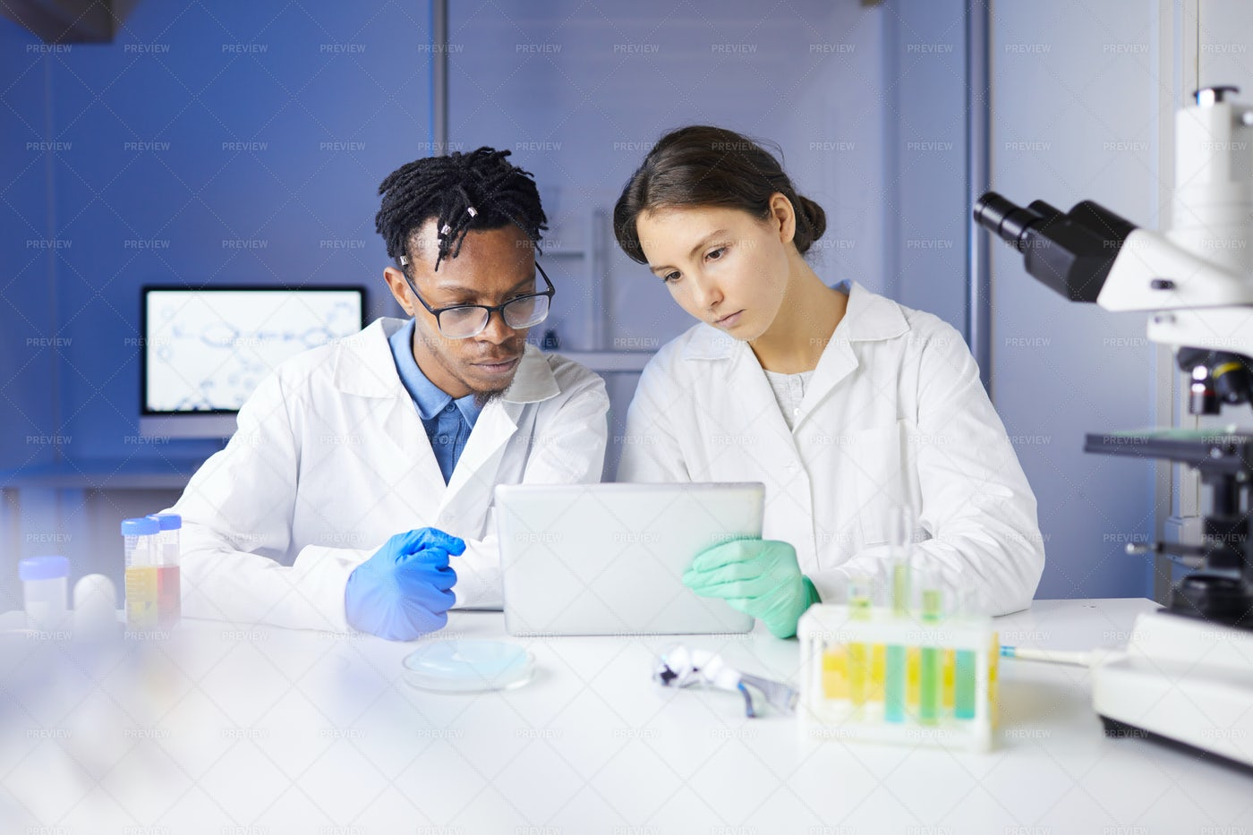 Team Of Young Scientists Working In...: Stock Photos