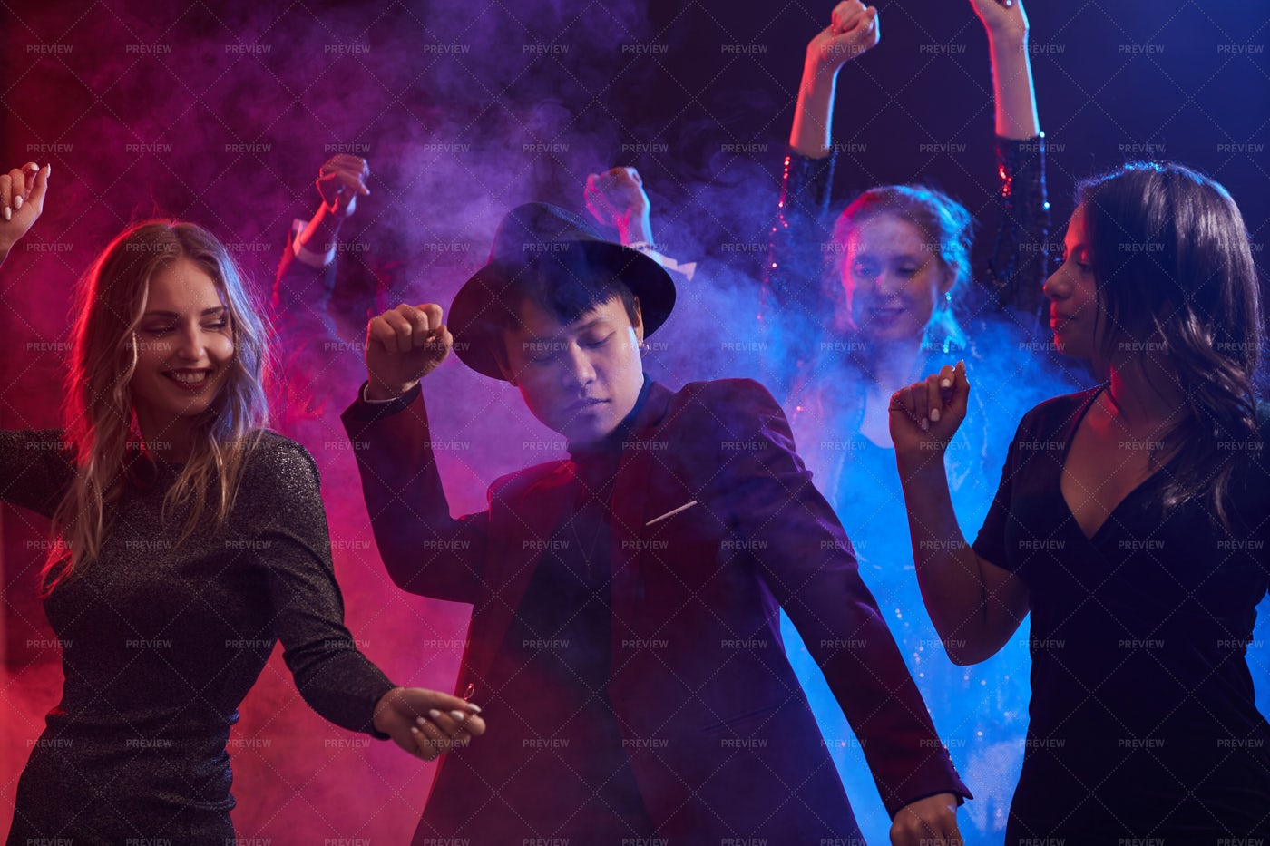 Young People Dancing In Smoky...: Stock Photos