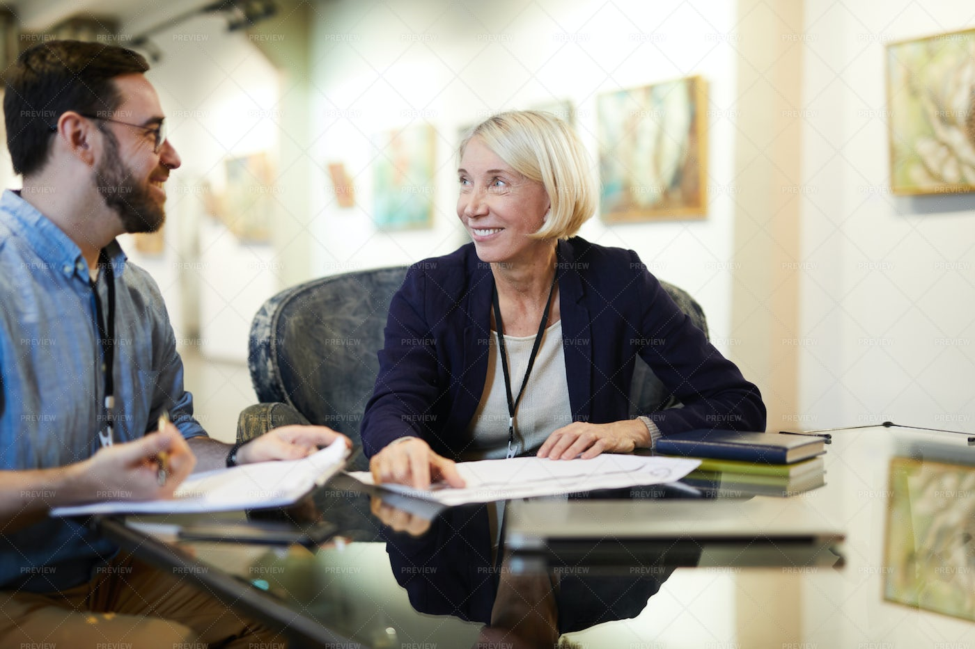 Two People Planning Exhibition: Stock Photos