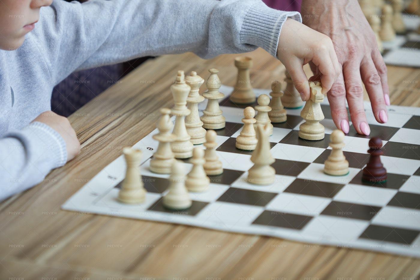 Teacher Showing Chess Move: Stock Photos