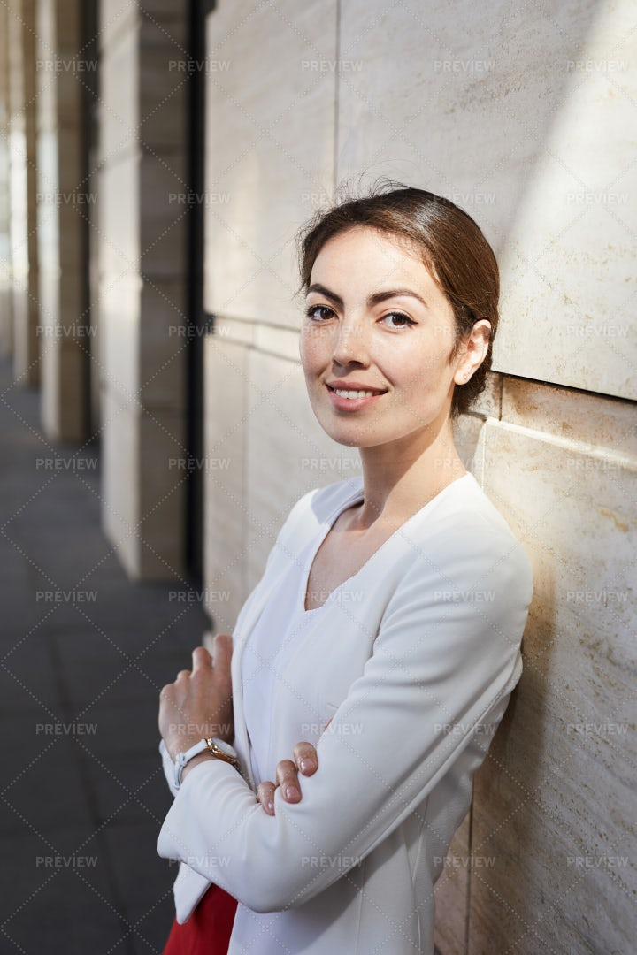 Young Businesswoman Looking At...: Stock Photos