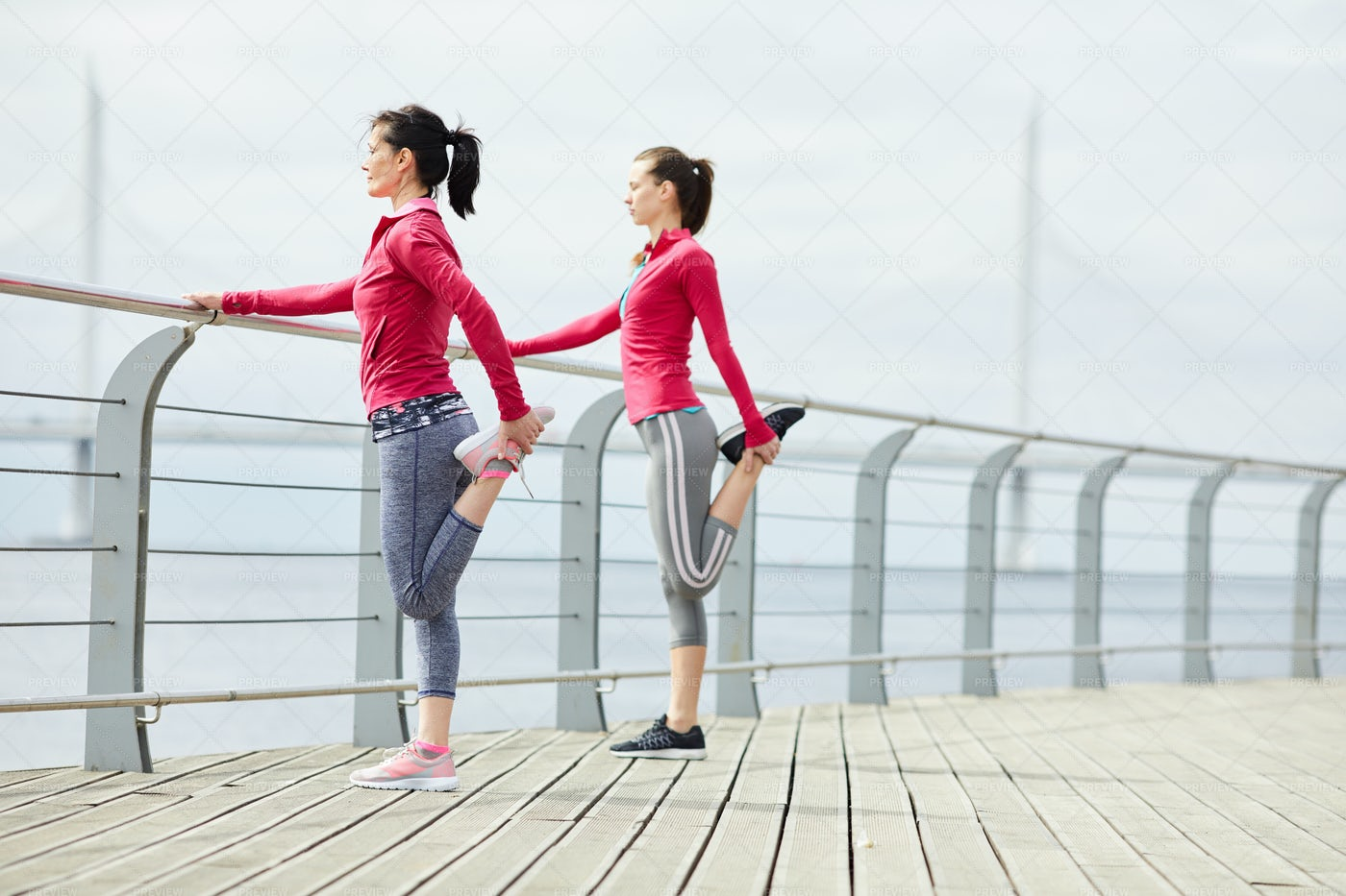 Women Stretching On Pier: Stock Photos