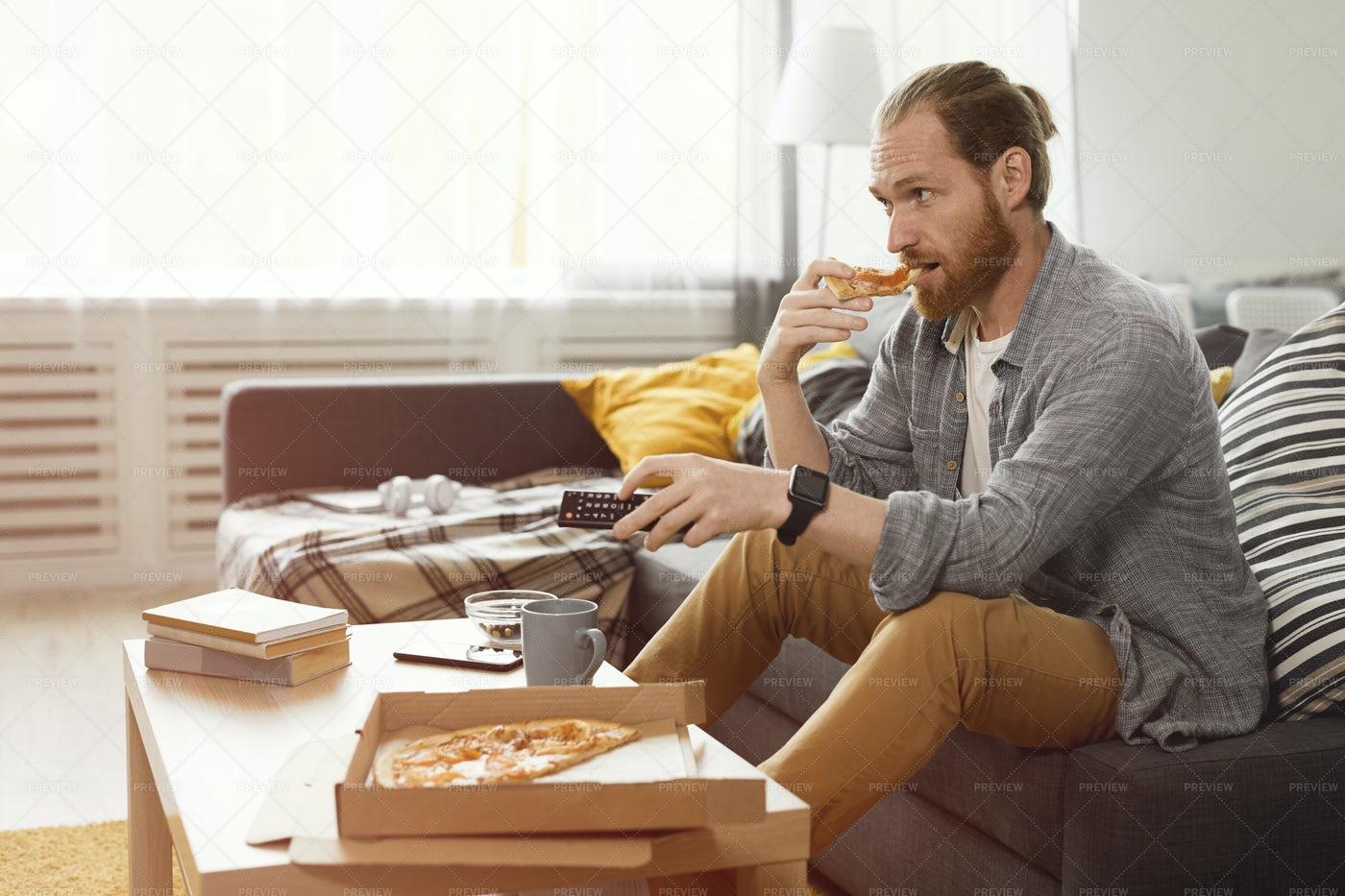 Man Binge Watching TV: Stock Photos
