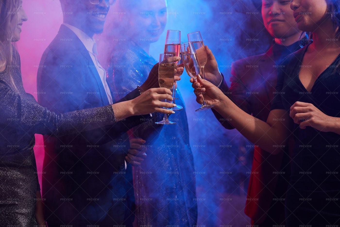 People Enjoying Party In Smoky...: Stock Photos