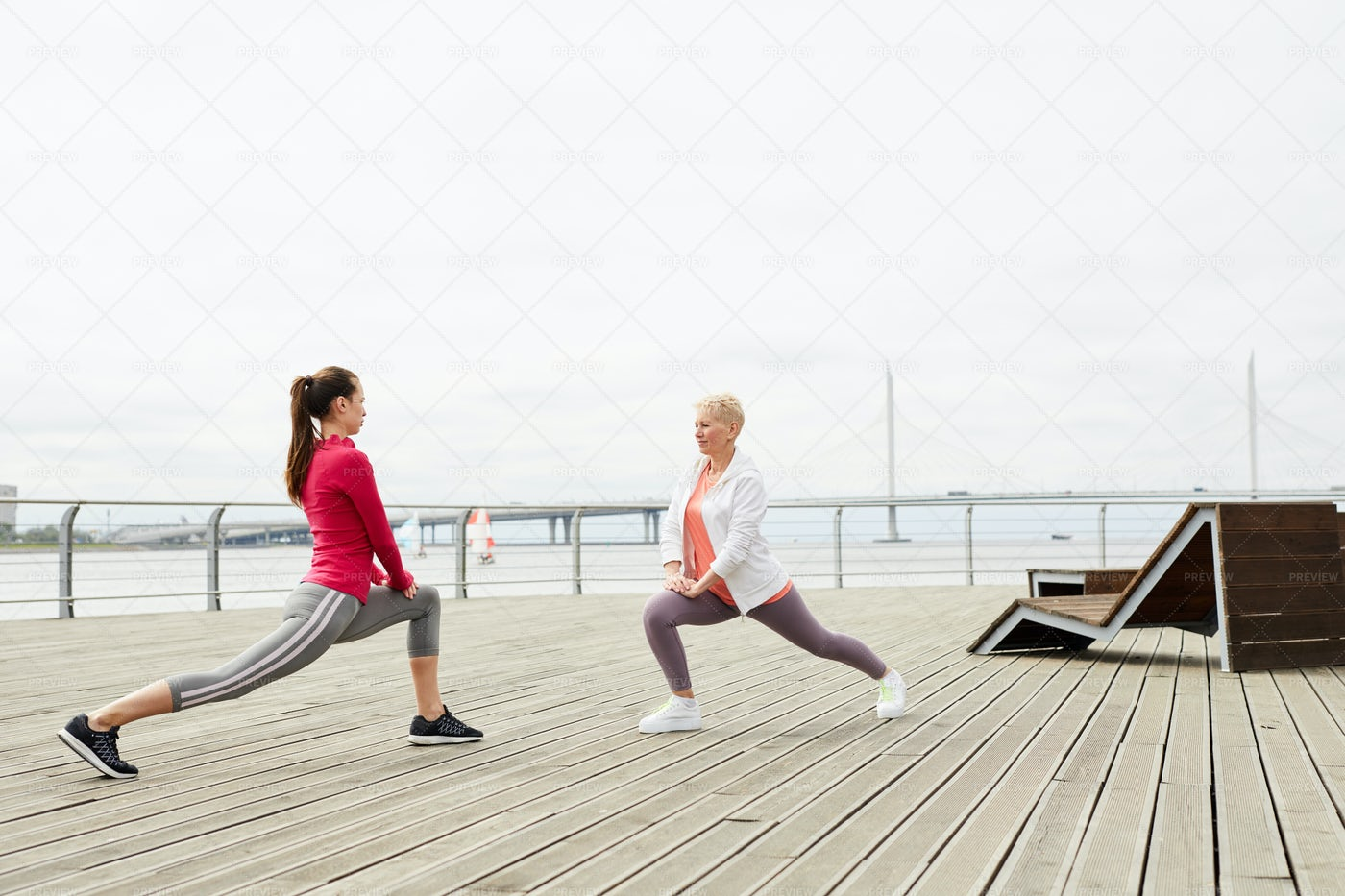 Women Stretching By Water: Stock Photos