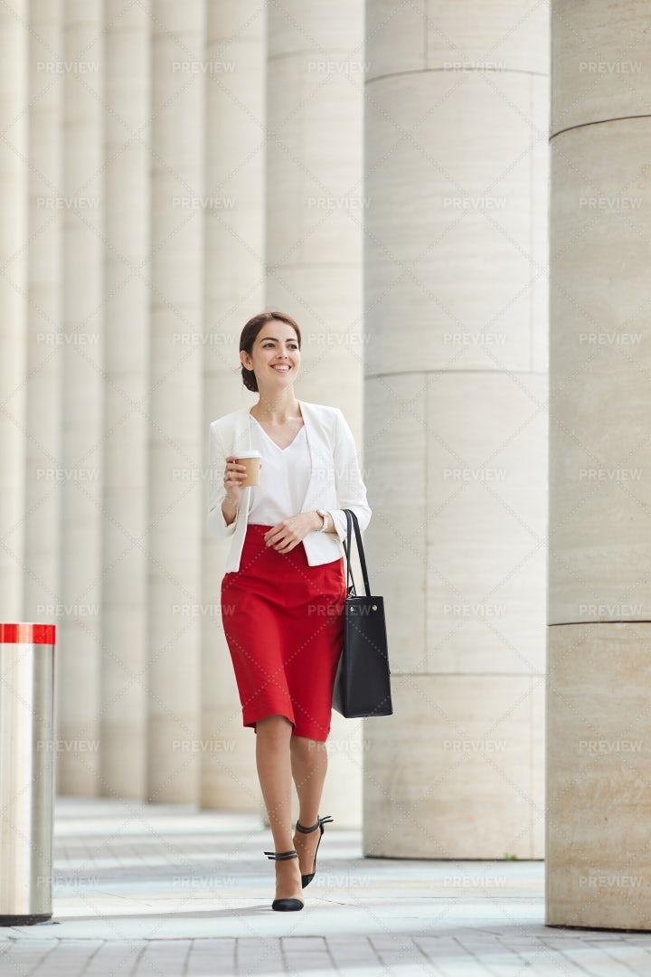 Businesswoman Walking In City: Stock Photos
