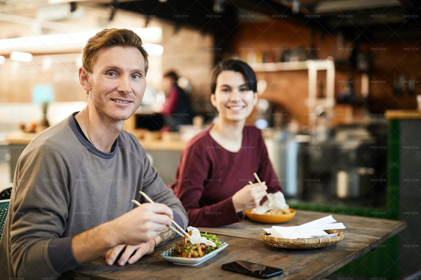Smiling Guests In Asian Food...: Stock Photos