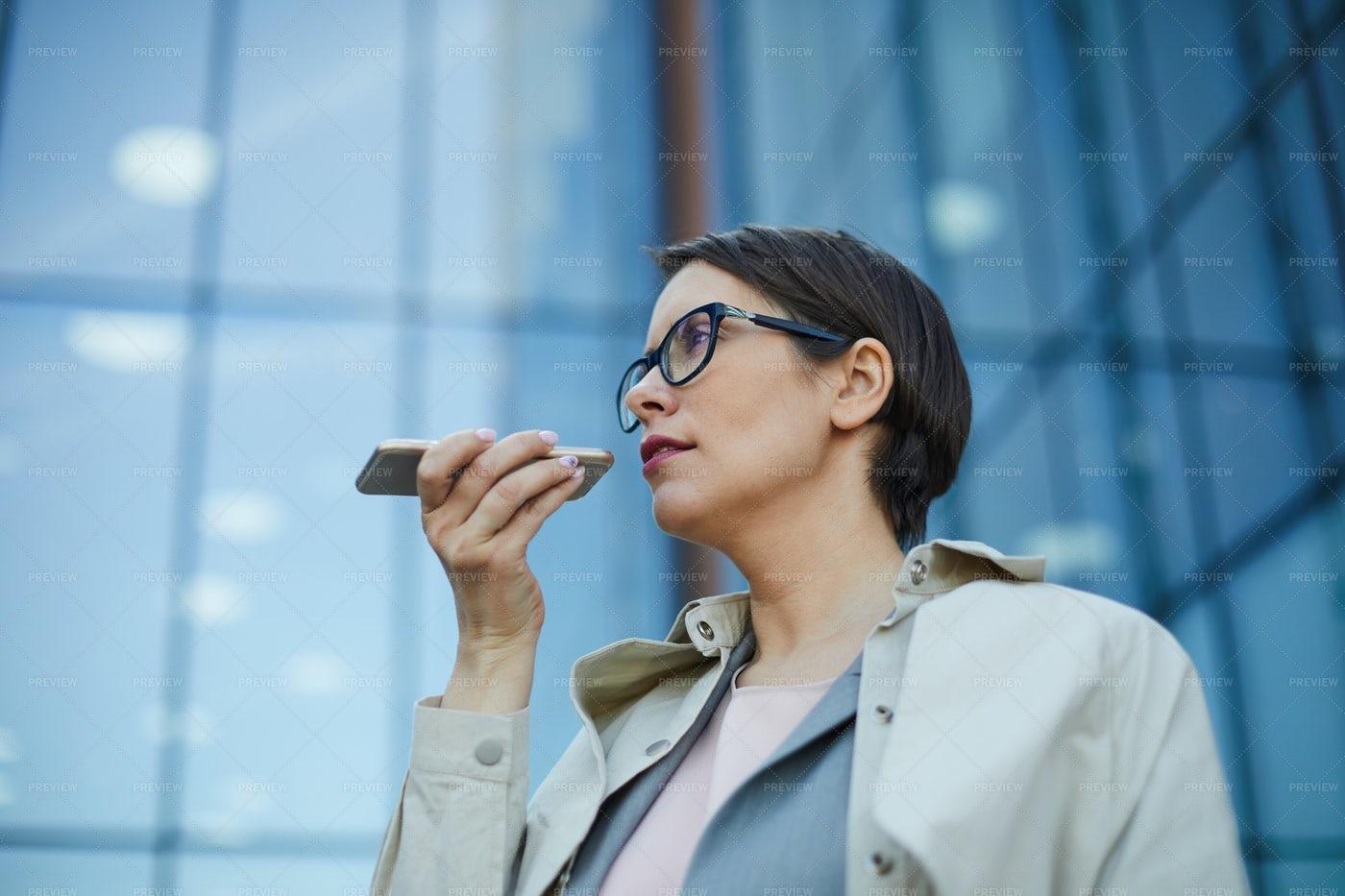 Businesswoman Recording Voice...: Stock Photos