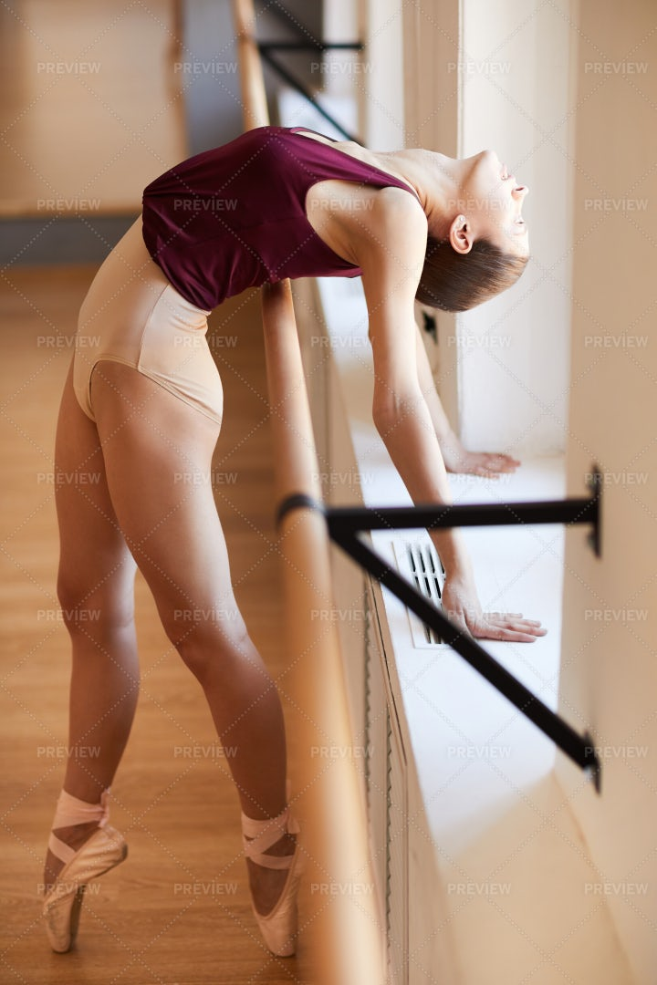 Flexible Girl Training With Barre: Stock Photos