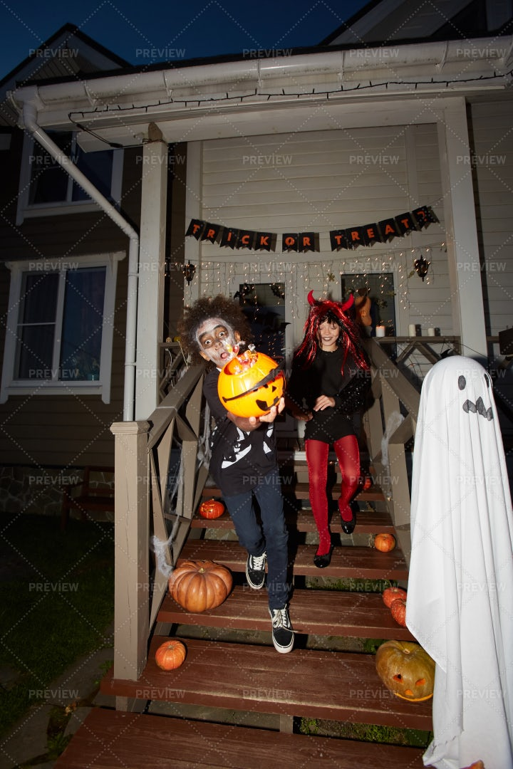 Kids Running Out On Halloween: Stock Photos