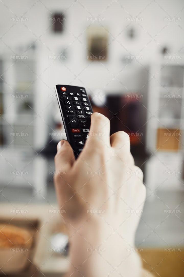 Closeup Hand Holding TV Remote: Stock Photos