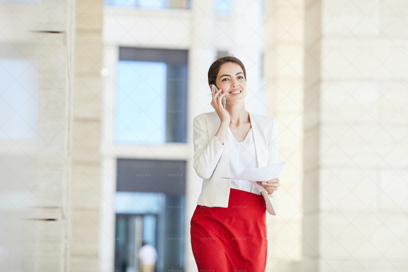 Beautiful Businesswoman Speaking By...: Stock Photos