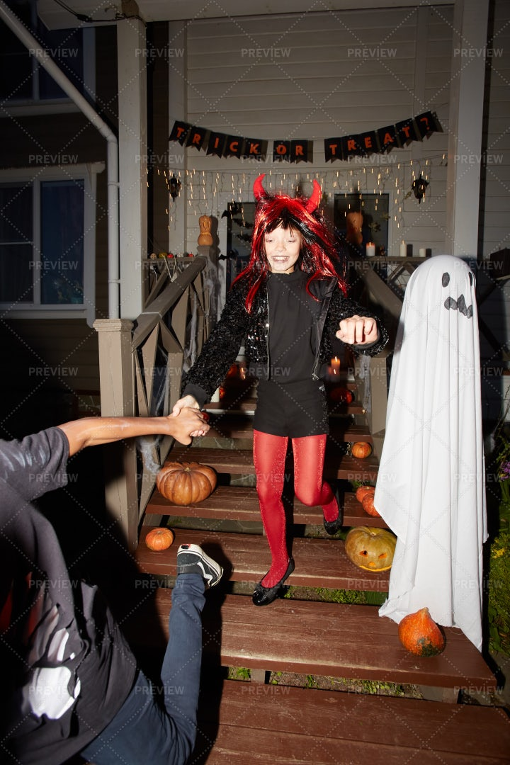 Children Run Out Of Haunted House: Stock Photos
