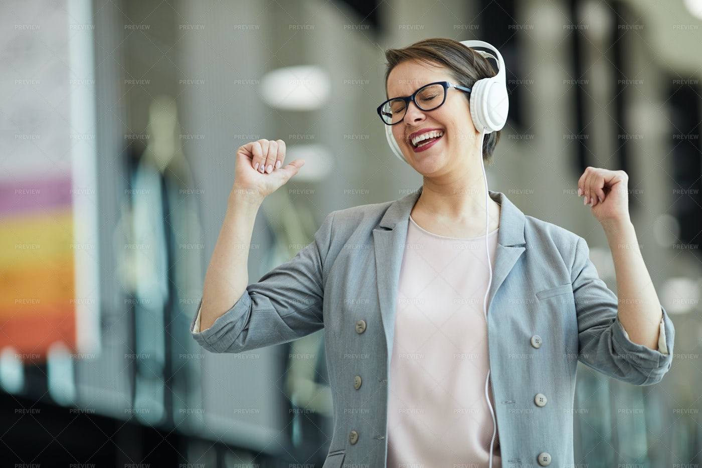 Jolly Woman Dancing In Excitement: Stock Photos