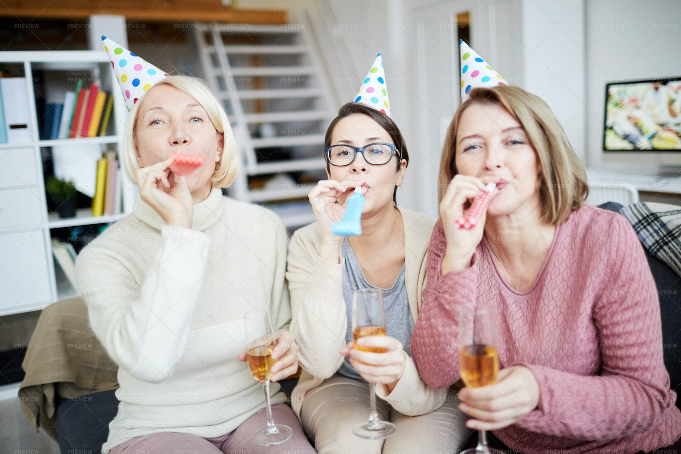 Women Blowing Party Horns: Stock Photos