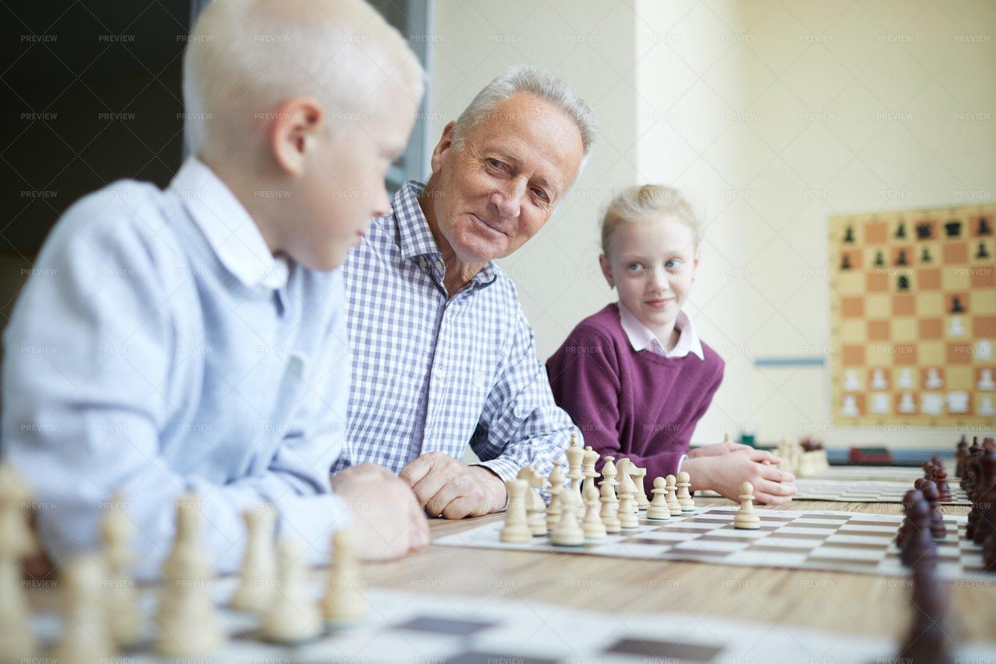 Grandfather Teaching Grandkids: Stock Photos