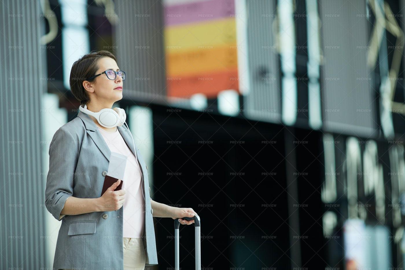 Modern Woman Reading Flight...: Stock Photos