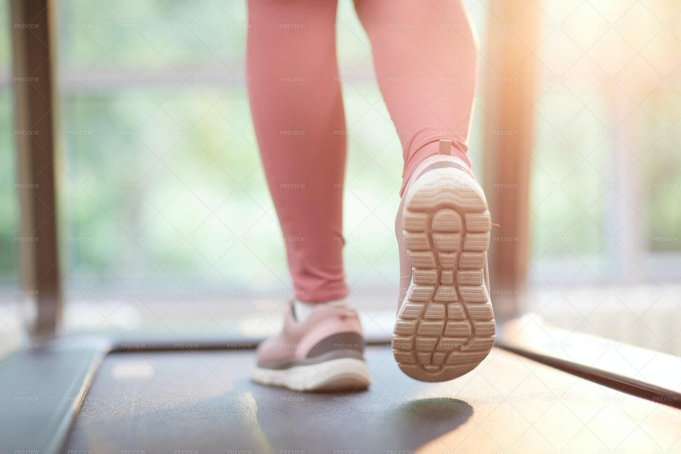 Feet Running On Treadmill: Stock Photos