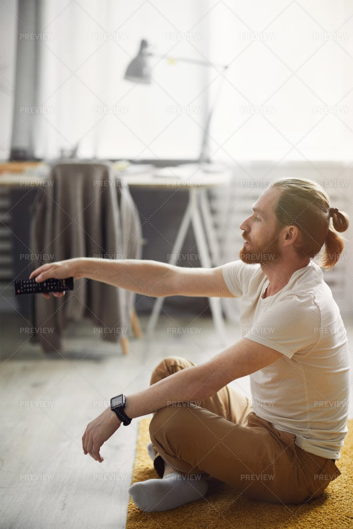 Contemporary Man Watching TV On...: Stock Photos