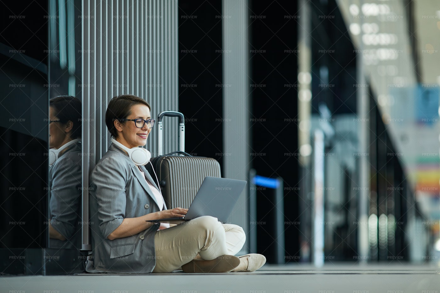 Smiling Lady Working In Airport: Stock Photos