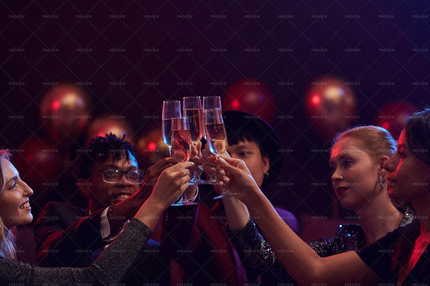 Friends Raising Champagne Glasses...: Stock Photos