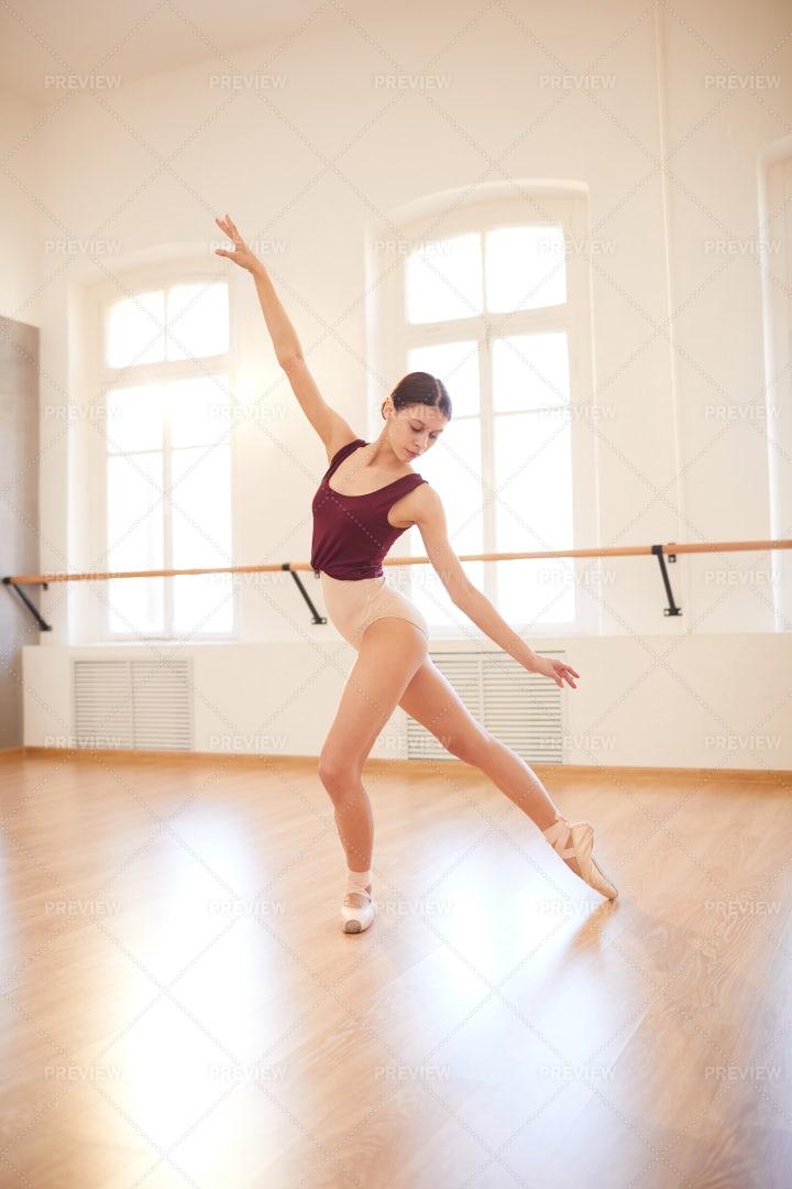Female Dancer Training In Empty...: Stock Photos