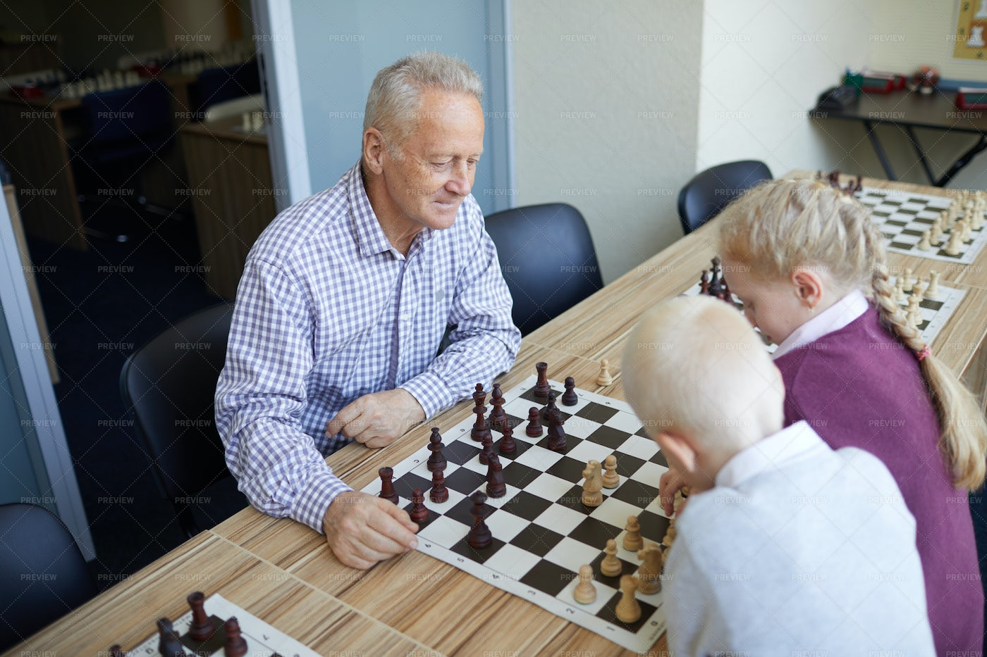 Grandfather Playing Chess: Stock Photos