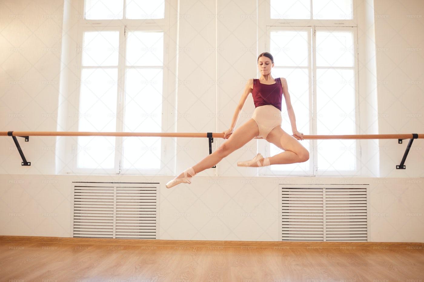 Ballerina Doing Elegant Pull-up On...: Stock Photos